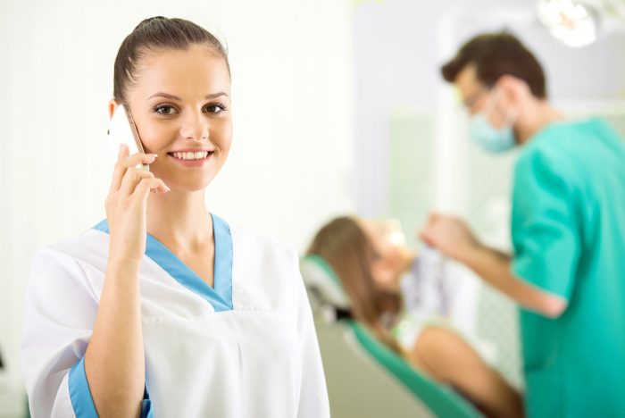 Dental Assistant Gets Settlement After Being Fired for Texting